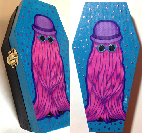 A painted coffin-shaped box