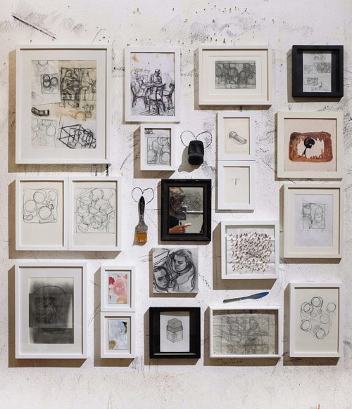 An assemblage of small works of art in frames