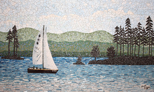An eggshell mosaic depicting a sailboat on still water