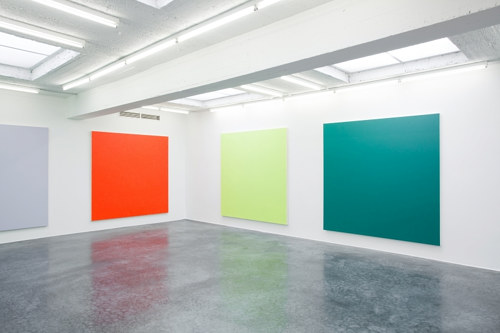 An installation view of several colorful monochromes