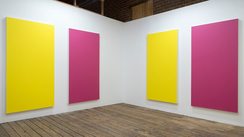 An installation view of some pink and yellow monochromes
