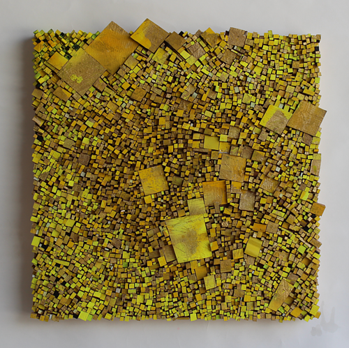 An assemblage artwork made with chunks of wood painted yellow