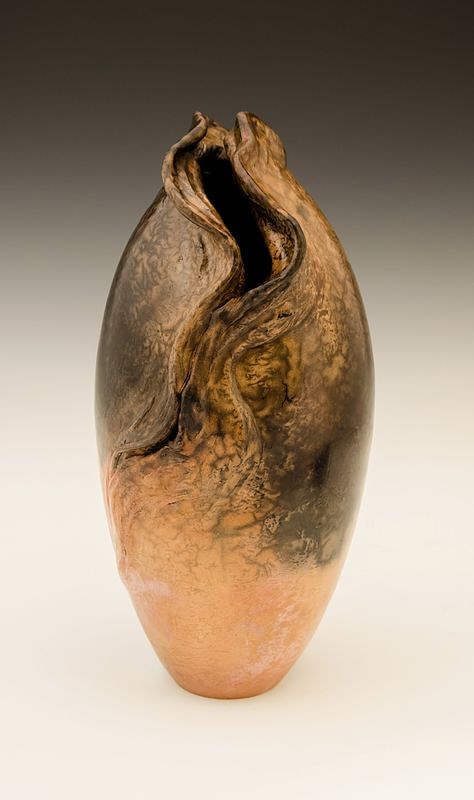 A tall sculptural vase