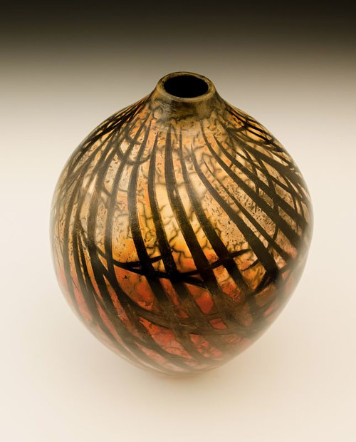 A vase with crossed darkened lines