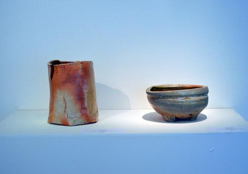 A ceramic vase and bowl on display