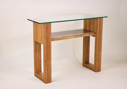 A console table made from hardwood and glass