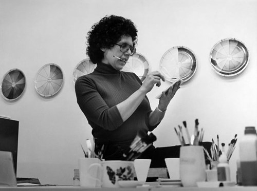 A photo of Judy Chicago in her ceramic painting studio