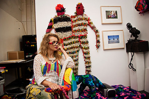 A photo of the artist Olek in her studio