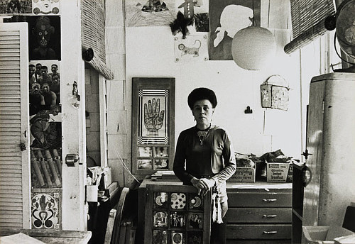 A photo of Betye Saar in her art studio in the 1970's