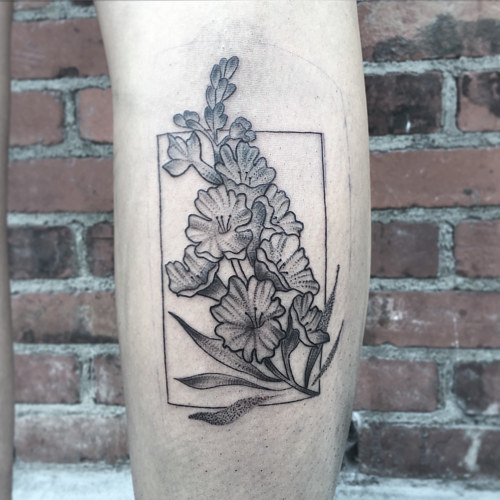 A floral tattoo with a line border