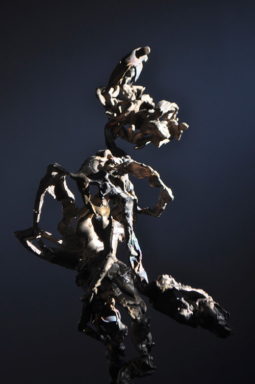 A photo of an abstract sculpture with dramatic lighting