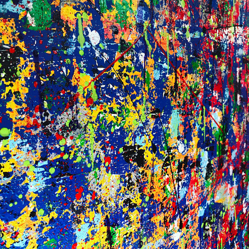 A bright painting with splatter patterns