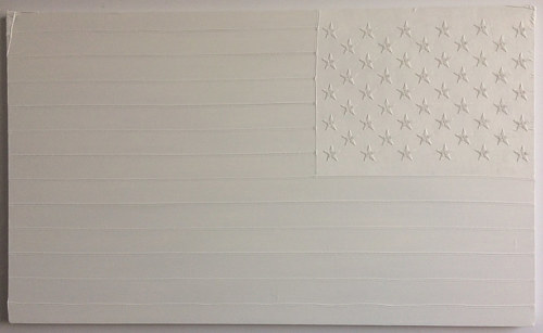 An american flag embroidered onto a canvas and painted white