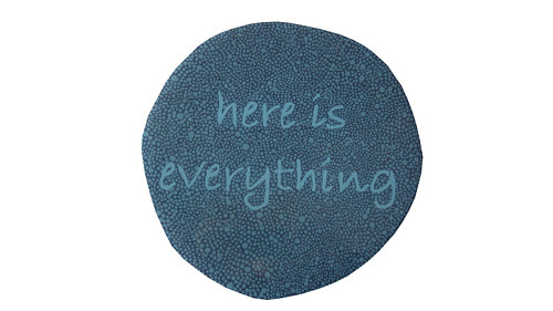 "A sign on a rounded panel reading ""here is everything."""