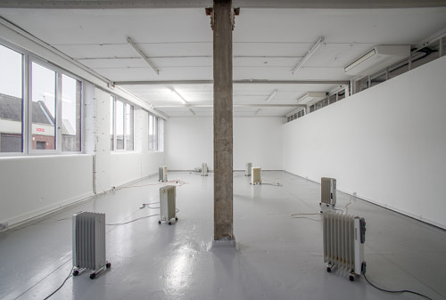 A photograph of a gallery installation of radiators