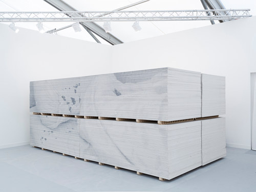 An installation featuring a large palette of plasterboard
