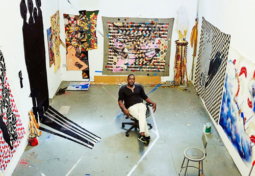 A photo of Sanford Biggers in his art studio
