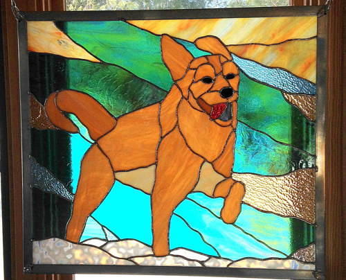 A stained glass artwork depicting a running dog