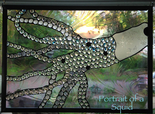 A stained glass artwork of a squid