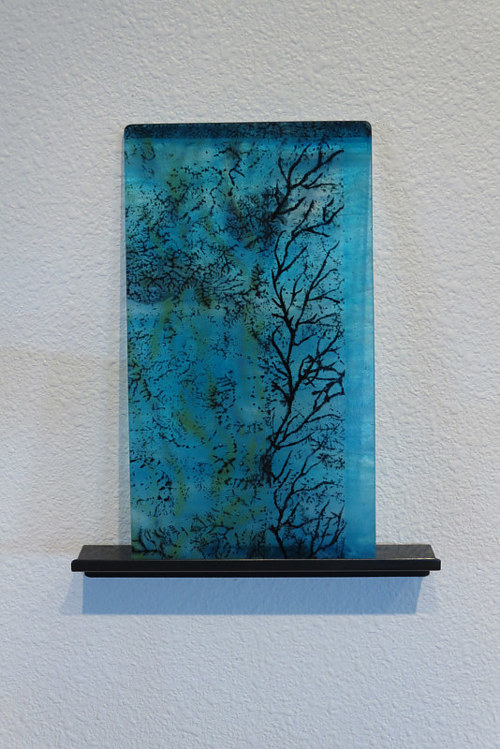 A kiln formed glass artwork designed as a wall-hanging