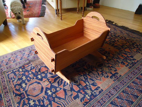 A handmade heritage baby cradle