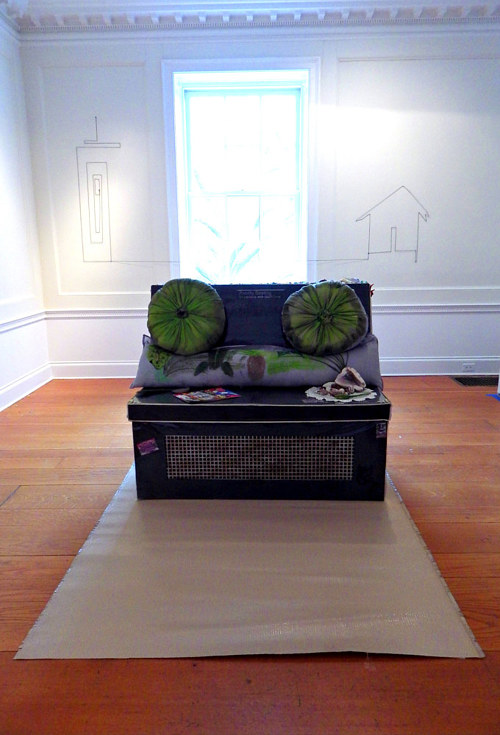 A photograph of an installtion in the shape of a sofa