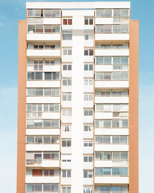 A photograph of an apartment building with minimalist composition