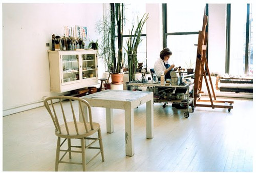A photo of Vija Clemins working in her studio