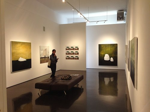 Photo of woman standing in gallery