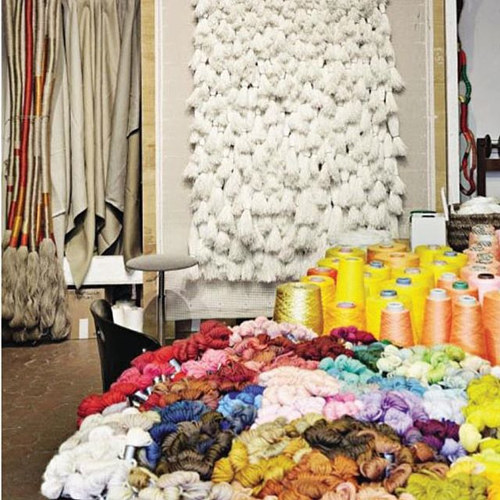 A photo of rolls of fabric in Sheila Hicks' studio