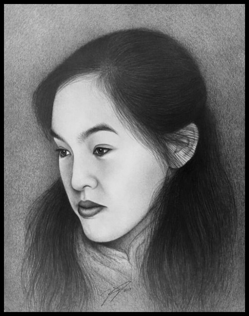 A pencil portrait of a young woman in profile