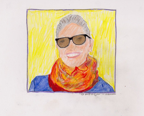 A portrait of an older woman in sunglasses