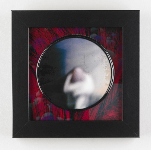 An artwork depicting a blurred figure in a round frame