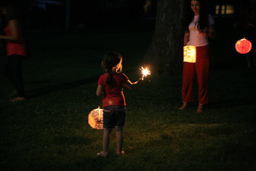 A photo of a child holding up a lantern