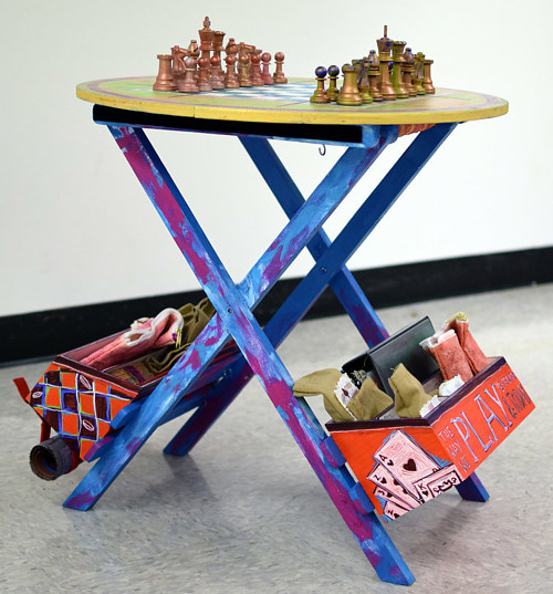 A mobile play table with a chess or checkers board