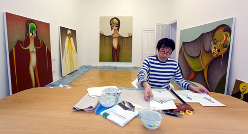 A photo of Izumi Kato at work in his studio
