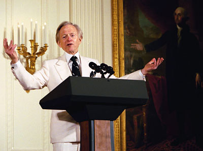 A photo of the late Tom Wolfe speaking at the White House