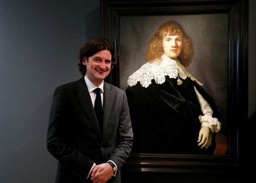 A photo of art dealer Jan Six with a newly discovered Rembrandt