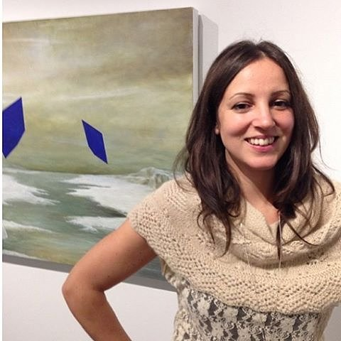 Artist Rebecca Chaperon in front of her painting