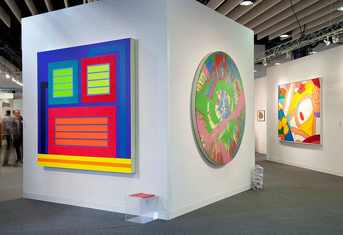 Booth at art fair with colorful paintings
