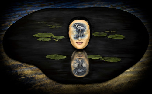 An art print depicting a mask reflected in still water