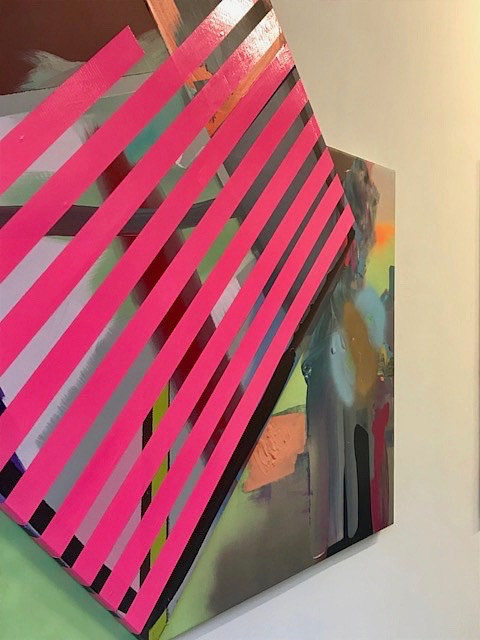 An abstract painting covered in strips of pink tape