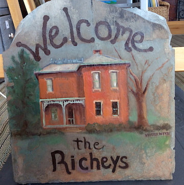 A welcome plaque painted on slate