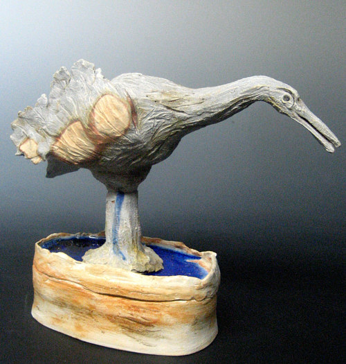 A sculpted bird with a heavy base