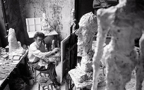 A photo of Alberto Giacometti working in his studio