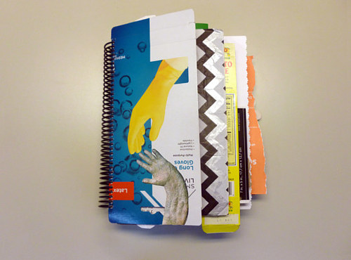 A book made from junk mail and shopping coupons