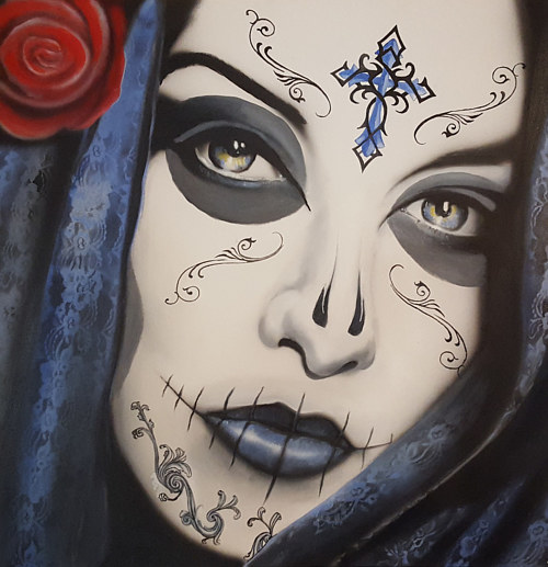 A painting of a woman in sugar-skull makeup