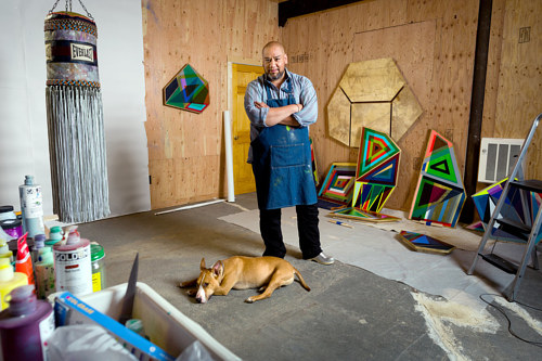A photo of Jeffrey Gibson at work in his studio