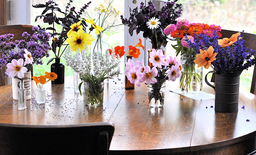 A photo of several floral arrangements on a table