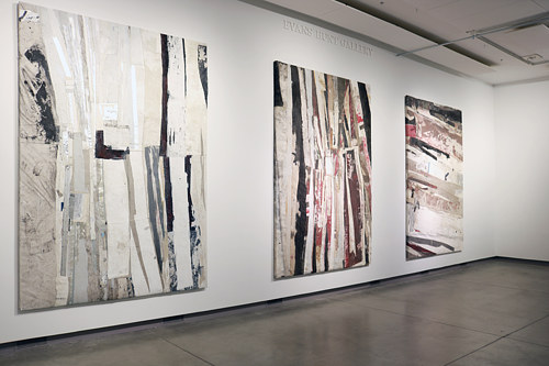 An installation view of three large patchwork paintings